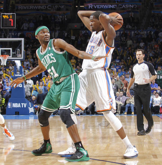 Boston Celtics point guard Keyon Dooling (51) tries to defense on Oklahoma City Thunder small forward Kevin Durant (35) during the NBA basketball game between the Oklahoma City Thunder and the Boston Celtics at the Chesapeake Energy Arena on Wednesday, Feb. 22, 2012 in Oklahoma City, Okla.  Photo by Chris Landsberger, The Oklahoman