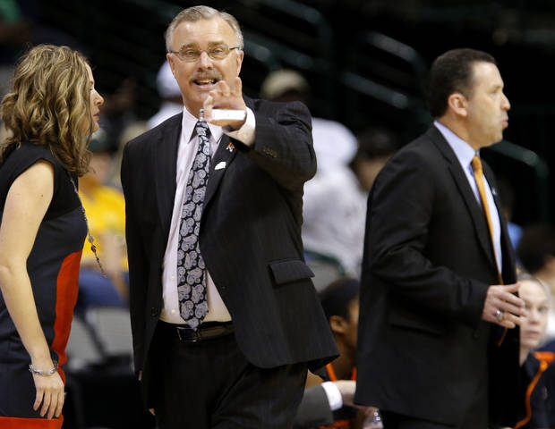 Oklahoma State coach Jim Littell shouts instructions during the Big 12 tournament women's college basketball game between Oklahoma State University and Texas Tech University at American Airlines Arena in Dallas, Saturday, March 9, 2012. Oklahoma State won 59-54.  Photo by Bryan Terry, The Oklahoman