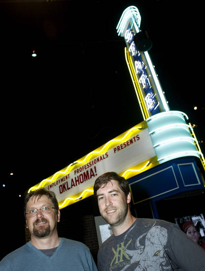 Larry O'Dell, left, and David Davis in front of the marquee at  the Oklahoma @ The Movies exhibit at the Oklahoma History Center Friday, May 4, 2012. Photo by Doug Hoke, The Oklahoman