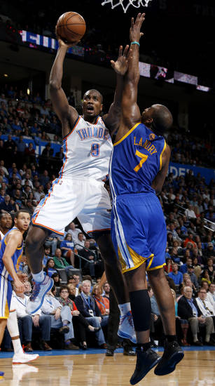 Oklahoma City's Serge Ibaka (9) goes to the basket beside Golden State's Carl Landry (7) during an NBA basketball game between the Oklahoma City Thunder and the Golden State Warriors at Chesapeake Energy Arena in Oklahoma City, Wednesday, Feb. 6, 2013. Photo by Bryan Terry, The Oklahoman