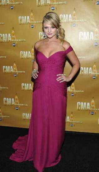 Country music star Miranda Lambert, who lives in Tishomingo, wears a Sherri Hill gown on the black carpet at November's Country Music Association Awards. (Associated Press file photo)