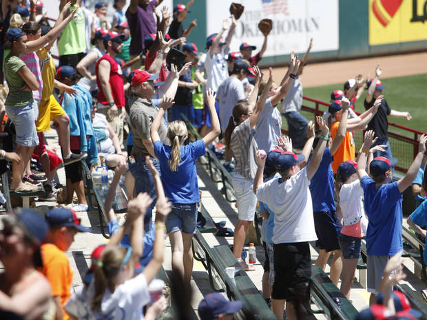 OKLAHOMA CITY REDHAWKS / MINOR LEAGUE BASEBALL / KIDS DAY / CHILD / CHILDREN: Schoolchildren cheer during Kids Day at the Chickasaw Bricktown Ballpark in Oklahoma City, OK, Tuesday, May 14, 2013,  By Paul Hellstern, The Oklahoman