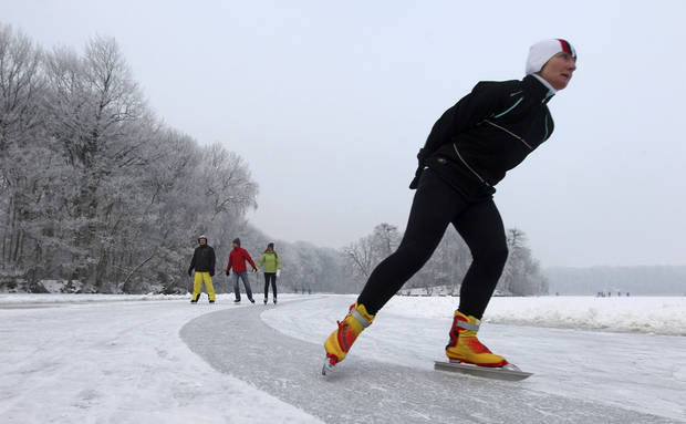 A woman skates on a pond in Aalter, 75 kilometers (47 miles) west of Brussels, Wednesday, Jan. 23, 2013. Belgium has been in the grip of cold and snowy weather for a week. (AP Photo/Yves Logghe)