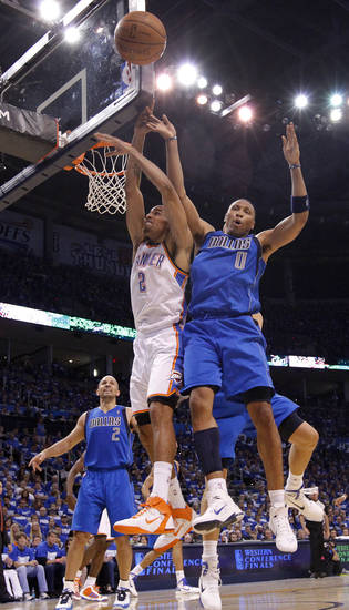 Oklahoma City's Thabo Sefolosha (2) battles for a rebound with Shawn Marion (0) of Dallas during game 3 of the Western Conference Finals of the NBA basketball playoffs between the Dallas Mavericks and the Oklahoma City Thunder at the OKC Arena in downtown Oklahoma City, Saturday, May 21, 2011. Photo by Chris Landsberger, The Oklahoman