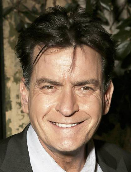 "FILE - This June 26, 2012 file photo shows actor Charlie Sheen attending the FX Summer Comedies Party at Lure in Los Angeles. Sheen's FX sitcom ""Anger Management"" is half-way through its initial 10-episode run and poised to get an order for 90 more. Sheen told reporters Saturday, July 28, 2012, that the prospect of continuing is as ""exciting as hell,"" and added cheerily, ""I don't think 90's gonna be enough."" (Photo by Todd Williamson/Invision/AP, File) ORG XMIT: NY110"