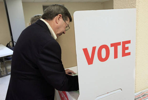 Attorney General Drew Edmondson, gubernatorial candidate, marks his ballot in the voting booths at precinct 574, Sooner and Hefner Road, in northeast Oklahoma City Tuesday, July 27, 2010. Photo by Paul B. Southerland, The Oklahoman