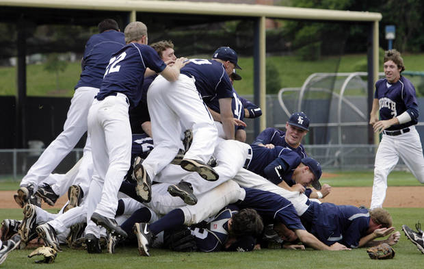 The Edmond North Huskies dogpile on the infield after defeating the Broken Arrow Tigers in the 6A State Baseball Championship at Oral Roberts University in Tulsa, OK, May 12, 2012. MICHAEL WYKE/Tulsa World