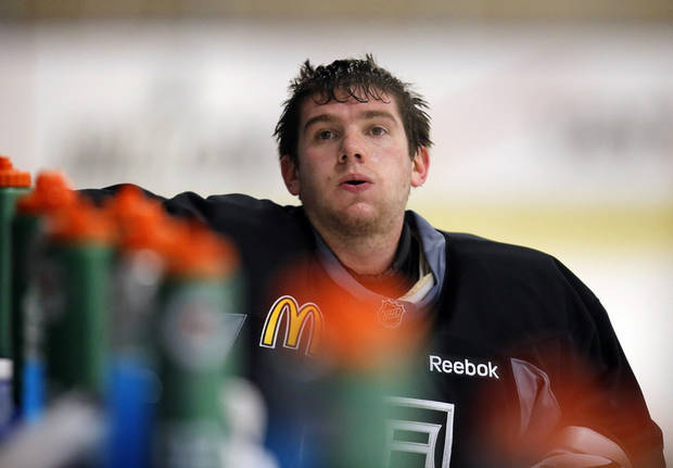 Los Angeles Kings goalie Jonathan Quick takes a short break during NHL hockey practice in El Segundo, Calif., Friday, Jan. 18, 2013. The Kings will host the Chicago Blackhawks in the season opener on Saturday. With 48 games crammed into roughly three months recovery time will be at a premium. Goaltenders use to playing every minute of every game will have to pace themselves, maybe even take some extra nights off, to stay fresh. (AP Photo/Jae C. Hong)