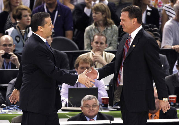 Kentucky head coach John Calipari, left, greets Kansas head coach Bill Self before the NCAA Final Four tournament college basketball championship game Monday, April 2, 2012, in New Orleans. (AP Photo/Bill Haber)
