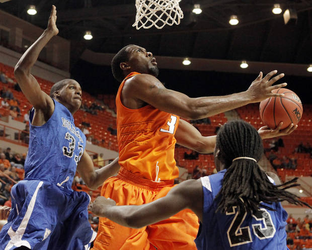 Oklahoma State's Matt Pilgrim (31) takes a shot between Dillard's Oscar Moore (33) and Avry Ingram (25) during an exhibition NCAA college basketball game in Stillwater, Okla., Tuesday, Nov. 10, 2009. (AP Photo/The Oklahoman, Nate Billings) ORG XMIT: OKOKL203