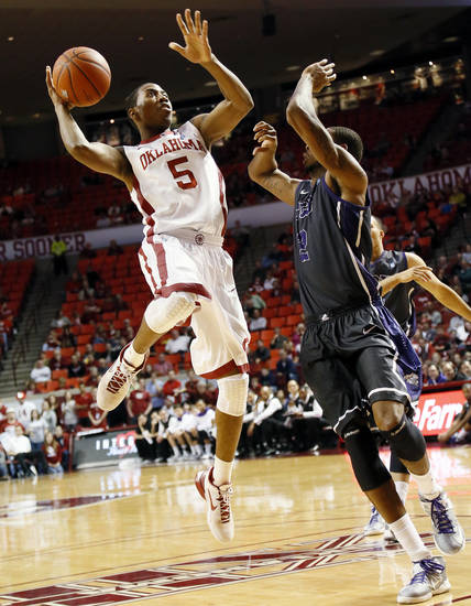 Oklahoma's Je'lon Hornbeak (5) tries to take a shot against TCU's Connell Crossland (2) during an NCAA men's basketball game between the University of Oklahoma (OU) and Texas Christian University (TCU) at the Lloyd Noble Center in Norman, Okla., Monday, Feb. 11, 2013. OU won, 75-48. Photo by Nate Billings, The Oklahoman