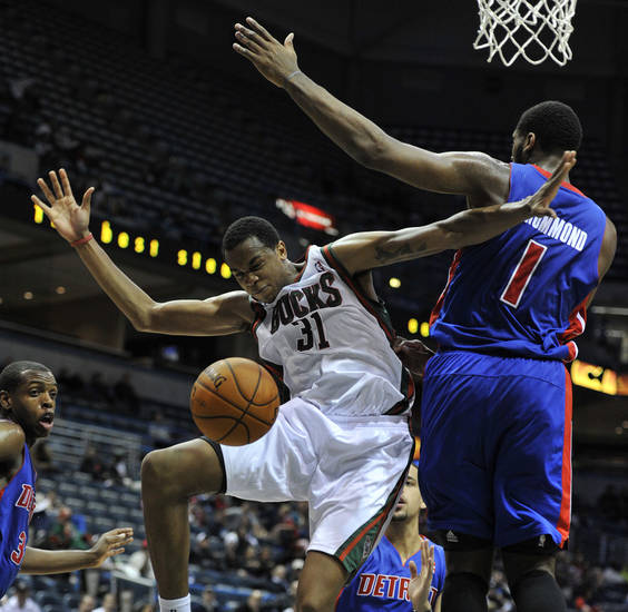 Milwaukee Bucks' John Henson (31) loses the ball as he drives to the basket around Detroit Pistons' Andre Drummond (1) during the second half of an NBA basketball game on Saturday, Oct. 13, 2012, in Milwaukee. The Bucks defeated the Pistons 108-91. (AP Photo/Jim Prisching)