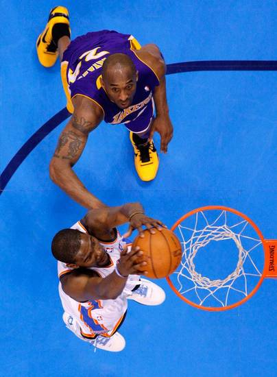 Oklahoma City's Kevin Durant (35) goes to the basket past Los Angeles' Kobe Bryant (24) during Game 1 in the second round of the NBA playoffs between the Oklahoma City Thunder and L.A. Lakers at Chesapeake Energy Arena in Oklahoma City, Monday, May 14, 2012. Photo by Bryan Terry, The Oklahoman