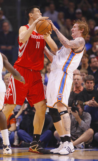 Robert Swift blocks a shot by Yao Ming in the first half as the Oklahoma City Thunder plays the Houston Rockets at the Ford Center in Oklahoma City, Okla. on Friday, January 9, 2009. 