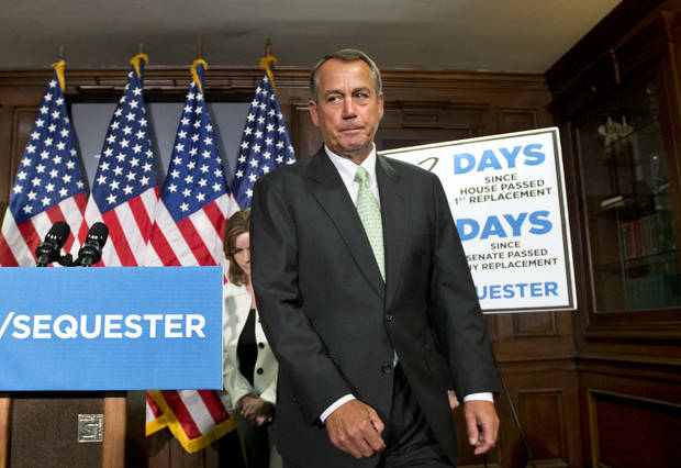"House Speaker John Boehner, R-Ohio wraps up a news conference on Capitol Hill in Washington, Tuesday, Feb. 26, 2013, where he and GOP leaders challenged President Obama and the Senate to avoid the automatic spending cuts set to take effect in four days. Boehner complained that the House, with Republicans in the majority, has twice passed bills that would replace the across-the-board cuts known as the ""sequester"" with more targeted reductions, while the Senate, controlled by the Democrats, has not acted. He is followed by Rep. Lynn Jenkins, R-Kansas is at left. (AP Photo/J. Scott Applewhite)"