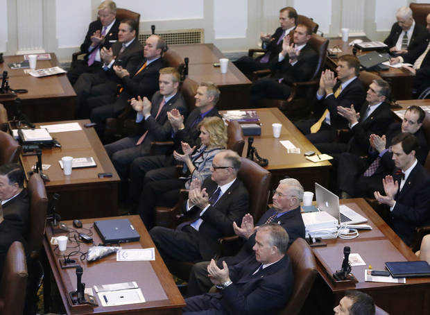 State legislators applaud as Oklahoma Gov. Mary Fallin gives her annual State of the State address in Oklahoma City, Monday, Feb. 4, 2013. (AP Photo/Sue Ogrocki) ORG XMIT: OKSO108