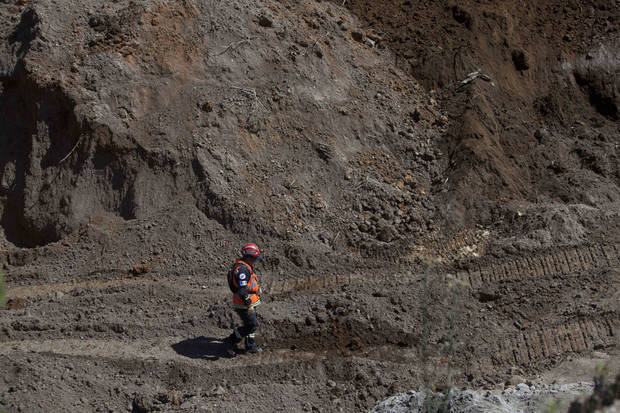 A rescue worker walks in a sand mine where people are feared to be buried after an earthquake in San Marcos, Guatemala, Thursday, Nov. 8, 2012. A magnitude 7.4 earthquake struck on Wednesday, killing at least 52 people and leaving dozens more missing. (AP Photo/Moises Castillo) ORG XMIT: GUA116