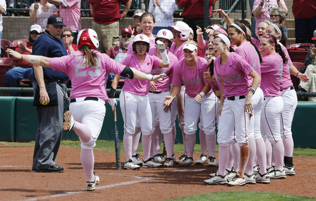 Teammates greet Brittany Williams after her home run hit as the University of Oklahoma (OU) Sooners play the Baylor Bears in NCAA college softball at Marita Hines Field on Saturday, April 6, 2013  in Norman, Okla. Photo by Steve Sisney, The Oklahoman