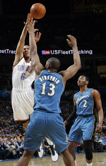 Oklahoma City's Eric Maynor (6) passes the ball around Kevin Seraphin (13) and John Wall (2) of Washington during the NBA basketball game between the Washington Wizards and the Oklahoma City Thunder at the Oklahoma City Arena in Oklahoma City, Friday, January 28, 2011. Photo by Nate Billings, The Oklahoman