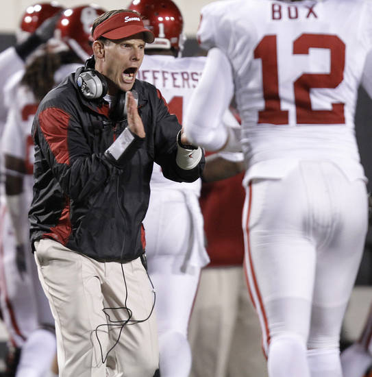 Oklahoma's Brent Venables cheers on his defensive squad after a stop against Oklahoma State during the Bedlam college football game between the University of Oklahoma Sooners (OU) and the Oklahoma State University Cowboys (OSU) at Boone Pickens Stadium in Stillwater, Okla., Saturday, Nov. 27, 2010. Photo by Chris Landsberger, The Oklahoman ORG XMIT: KOD