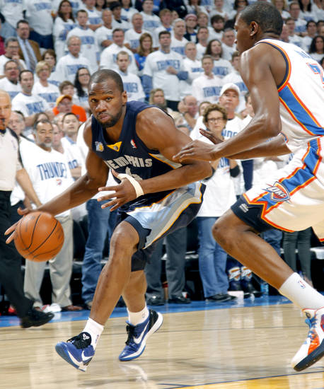 Sam Young (4) of Memphis tries to get by Oklahoma City's Kevin Durant (35)during game five of the Western Conference semifinals between the Memphis Grizzlies and the Oklahoma City Thunder in the NBA basketball playoffs at Oklahoma City Arena in Oklahoma City, Wednesday, May 11, 2011. Photo by Sarah Phipps, The Oklahoman