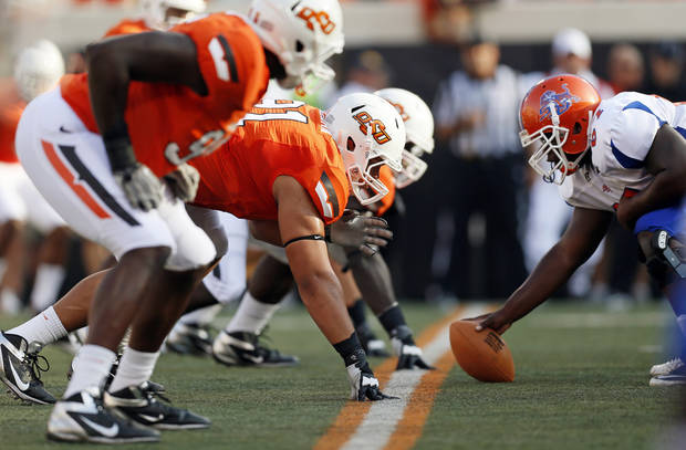 The OSU defense and Savannah State offense line up during a college football game between Oklahoma State University (OSU) and Savannah State University at Boone Pickens Stadium in Stillwater, Okla., Saturday, Sept. 1, 2012. Photo by Nate Billings, The Oklahoman