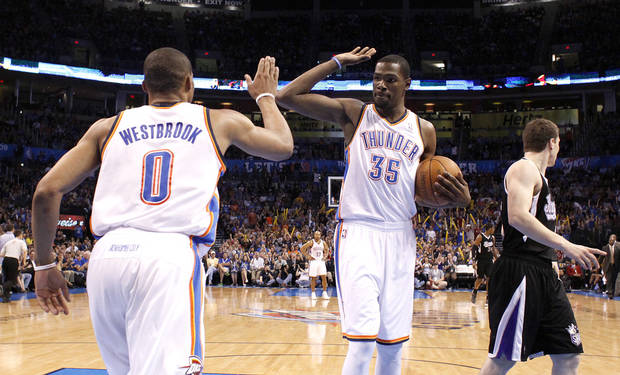 CELEBRATION: Oklahoma City's Russell Westbrook (0) and Kevin Durant (35) celebrate a dunk in front of Sacramento's Jimmer Fredette (7) during the NBA basketball game between the Oklahoma City Thunder and the Sacramento Kings at Chesapeake Energy Arena in Oklahoma City, Tuesday, April 24, 2012. Photo by Sarah Phipps, The Oklahoman.