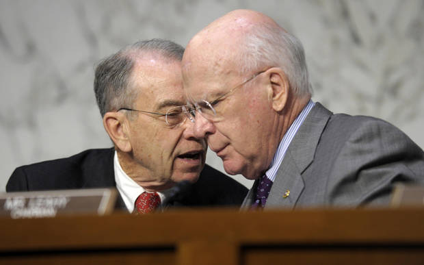 FILE � In this Feb. 13, 2013 file photo Senate Judiciary Committee Chairman Sen. Patrick Leahy, D-Vt., right, talks with the committee's ranking Republican Sen. Charles Grassley, R-Iowa, on Capitol Hill in Washington during the committee's hearing on comprehensive immigration reform. Leahy, 72, has served for nearly four decades in the upper chamber, and earned his perch as one of the Senate's most powerful, and visible, members. Now he is front and center in two of the most contentious fights facing a bitterly divided Senate: guns and immigration. (AP Photo/Susan Walsh, File)