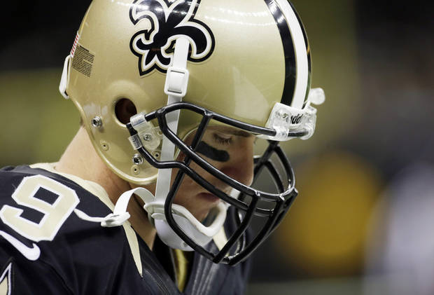 New Orleans Saints quarterback Drew Brees holds his head down during the second half of an NFL football game against the Carolina Panthers Sunday, Dec. 30, 2012, in New Orleans. (AP Photo/Dave Martin)