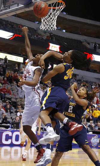 Oklahoma's Sharane Campbell (24) is fouls by West Virginia's Crystal Leary (32) in the final seconds as Taylor Palmer (2) watches during the Big 12 tournament women's college basketball game between the University of Oklahoma and West Virginia at American Airlines Arena in Dallas, Saturday, March 9, 2012. Oklahoma won 65-64.  Photo by Bryan Terry, The Oklahoman