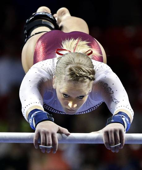 Rebecca Clark competes in the uneven bars as the University of Oklahoma Sooners (OU) compete at the NCAA, Women's Gymnastics Regional at The Lloyd Noble Center on Saturday, April 6, 2013  in Norman, Okla. Photo by Steve Sisney, The Oklahoman