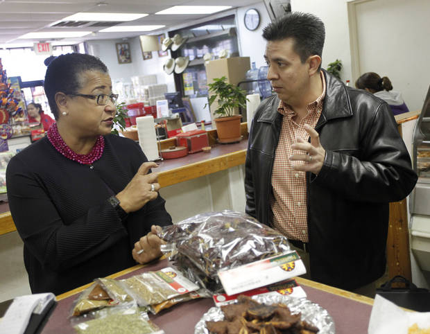 Tulsa manager Manuel Gomez talks with Small Business Administration Deputy Administrator Marie Johns in the cafe area while touring Supermercados Morelos in Oklahoma City, November 30, 2011. Photo by Doug Hoke, The Oklahoman