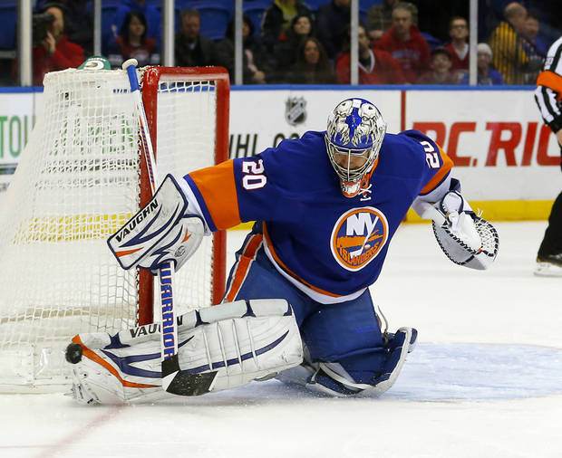 New York Islanders goalie Evgeni Nabokov (20) makes a save in the first period of an NHL hockey game against the Montreal Canadiens at the Nassau Coliseum in Uniondale, N.Y., Tuesday, March 5, 2013. (AP Photo/Paul J. Bereswill)