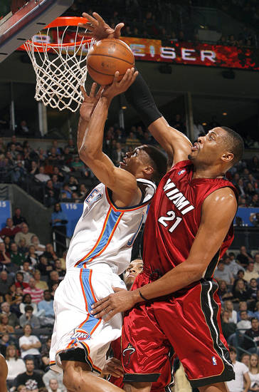 Oklahoma City's Russell Westbrook (0) shoots as Miami's Jamaal Magloire (21) defends him during the NBA game between the Oklahoma City Thunder and the Miami Heat Sunday Jan. 18, 2009, at the Ford Center in Oklahoma City. PHOTO BY SARAH PHIPPS, THE OKLAHOMAN