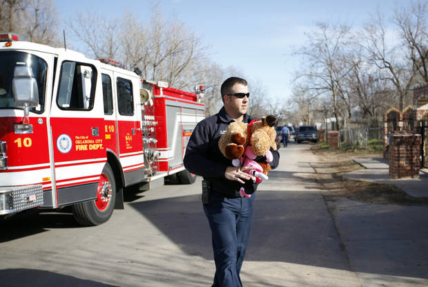 Oklahoma City firefighter Cpl. Bobby Jobes hands out toys in the Westlawn Gardens neighborhood in Oklahoma City, Saturday, Dec. 24, 2011. Photo by Sarah Phipps, The Oklahoman