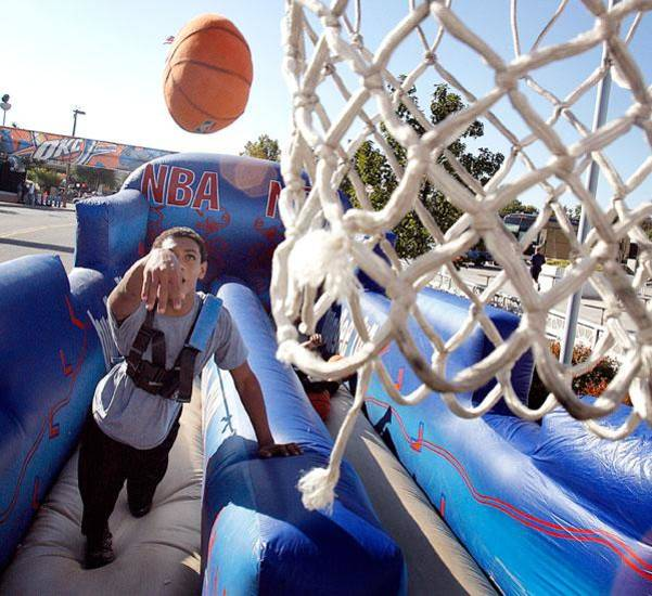 Micah Kee, 13, of Woodward, Okla. enjoys the outdoor fun before the opening night NBA basketball game between the Oklahoma City Thunder and the Milwaukee Bucks on Wednesday, Oct. 29, 2008, at the Ford Center in Oklahoma City, Okla.  BY CHRIS LANDSBERGER, THE OKLAHOMAN