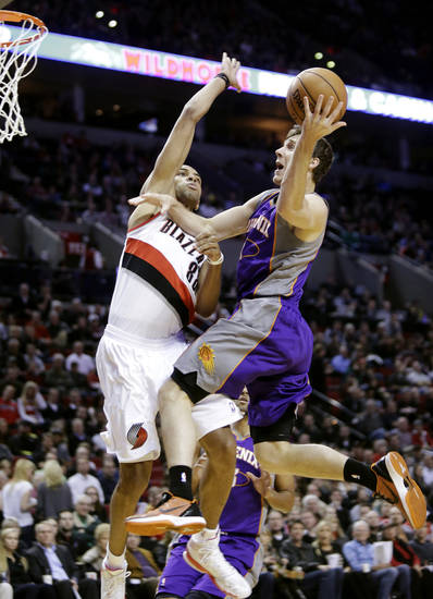 Phoenix Suns guard Goran Dragic, right, of Slovenia, goes to the basket against Portland Trail Blazers forward Nicolas Batum, of France, during the first quarter of an NBA basketball game in Portland, Ore., Tuesday, Feb. 19, 2013. (AP Photo/Don Ryan)