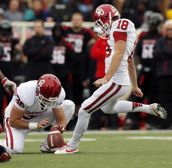 OU's Michael Hunnicutt (18) kicks a field goal as Tress Way (36) holds in the third quarter during a college football game between the University of Oklahoma (OU) and Texas Tech University at Jones AT&T Stadium in Lubbock, Texas, Saturday, Oct. 6, 2012. OU won, 41-20. Photo by Nate Billings, The Oklahoman