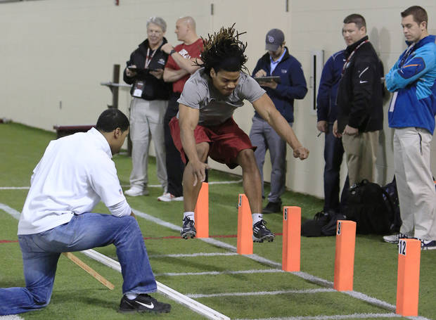Oklahoma football player Dominique Whaley runs a drill during pro day for NFL scouts at the Everest Indoor Center in Norman, Okla. on Wednesday, March 12, 2014. (AP Photo/Alonzo Adams)