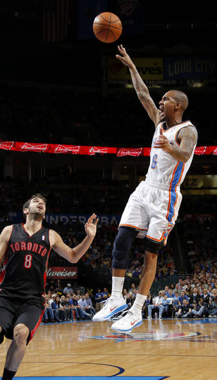 Oklahoma City's Eric Maynor (6) shoot the ball over Toronto's Jose Calderon (8) during an NBA basketball game between the Oklahoma City Thunder and the Toronto Raptors at Chesapeake Energy Arena in Oklahoma City, Tuesday, Nov. 6, 2012.  Tuesday, Nov. 6, 2012. Photo by Bryan Terry, The Oklahoman
