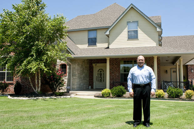 Doyle Province, vice president of mortgage lending at WEOKIE Credit Union, worked the mortgage loan that allowed a family to buy this house on Wimberly Drive in Yukon. Photo by Mitchell Alcala, The Oklahoman