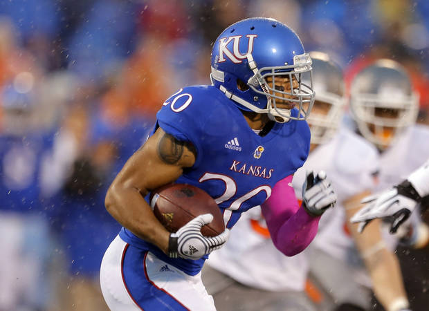 Kansas' D.J. Beshears (20) rushes during the college football game between Oklahoma State University (OSU) and the University of Kansas (KU) at Memorial Stadium in Lawrence, Kan., Saturday, Oct. 13, 2012. Photo by Sarah Phipps, The Oklahoman