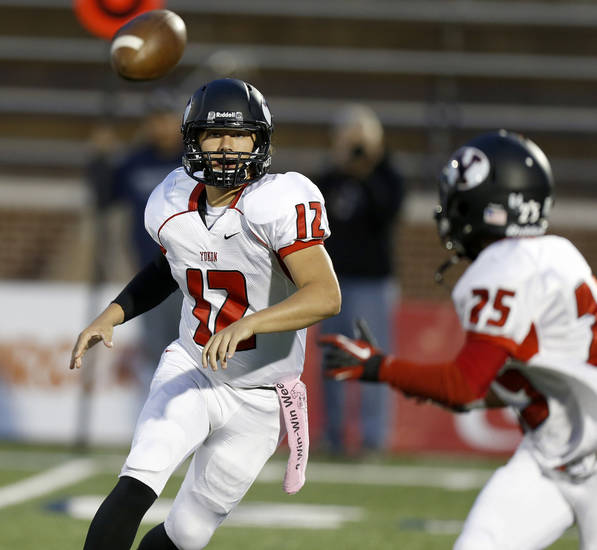 Yukon's Hayden Somerville throws the ball to Shawn Anderson during their high school football game against Edmond North at Wantland Stadium in Edmond, Okla., Thursday, October 4, 2012. Photo by Bryan Terry, The Oklahoman