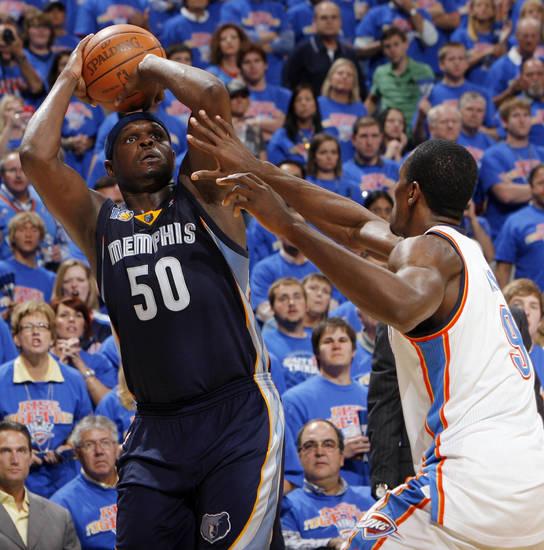 Zach Randolph (50) of Memphis takes a shot as Serge Ibaka (9) of Oklahoma City defends in the second half during game 7 of the NBA basketball Western Conference semifinals between the Memphis Grizzlies and the Oklahoma City Thunder at the OKC Arena in Oklahoma City, Sunday, May 15, 2011. The Thunder won, 105-90. Photo by Nate Billings, The Oklahoman