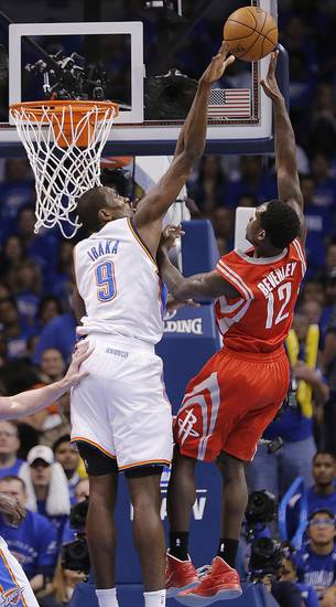 Oklahoma City's Serge Ibaka (9) blocks a shot by Houston's Patrick Beverley (12) during Game 2 in the first round of the NBA playoffs between the Oklahoma City Thunder and the Houston Rockets at Chesapeake Energy Arena in Oklahoma City, Wednesday, April 24, 2013. Photo by Chris Landsberger, The Oklahoman