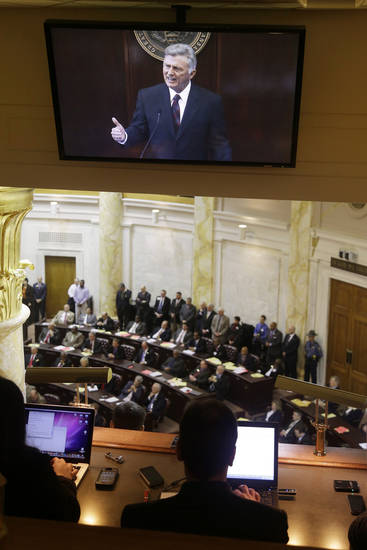 The image of Arkansas Gov. Mike Beebe is displayed on a video monitor in a gallery above the House chamber at the Arkansas state Capitol in Little Rock, Ark.,  as the governor delivers his State of the State address to a joint session of the House and Senate Tuesday, Jan. 15, 2013. (AP Photo/Danny Johnston)