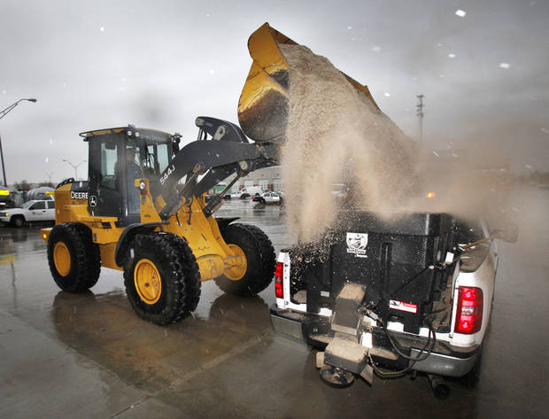 A small municipal salt truck is loaded at the municipal facility in SW Oklahoma City, Thursday, Jan. 28, 2010. By Paul Hellstern, The Oklahoman