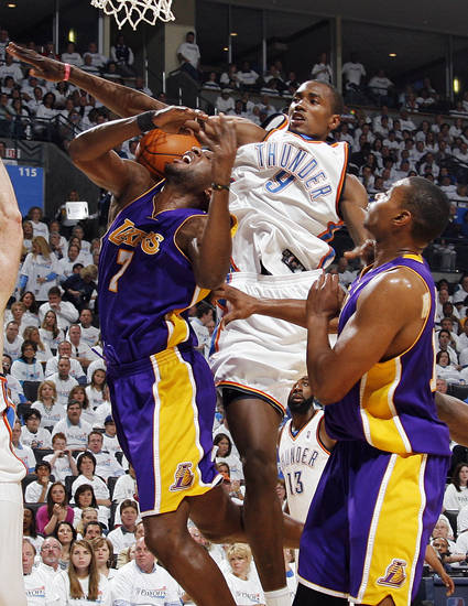 GAME FOUR / L.A. LAKERS: Oklahoma City's Serge Ibaka (9) fouls Lamar Odom (7) of L.A. next to Andrew Bynum (17) during the NBA basketball game between the Los Angeles Lakers and the Oklahoma City Thunder in the first round of the NBA playoffs at the Ford Center in Oklahoma City, Saturday, April 24, 2010. Photo by Nate Billings, The Oklahoman ORG XMIT: KOD