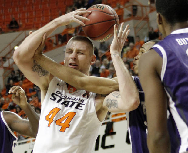 Oklahoma State&#039;s Philip Jurick (44) is could by TCU&#039;s Garlon Green (33) during the college basketball game between Oklahoma State University Cowboys (OSU) and Texas Christian University Horned Frogs (TCU) at Gallagher-Iba Arena on Wednesday Jan. 9, 2013, in Stillwater, Okla. 