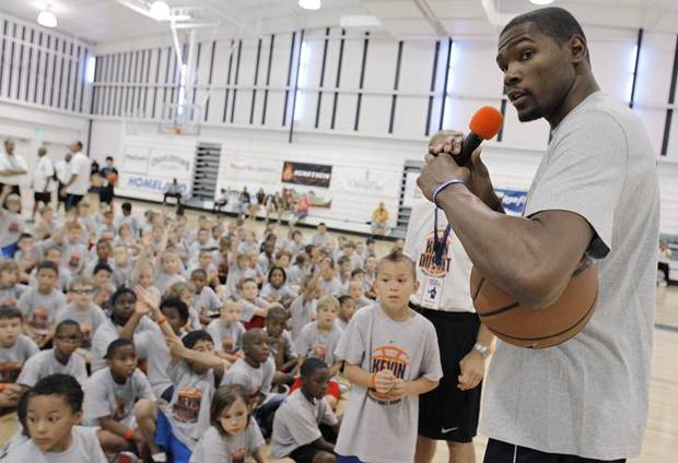 Kevin Durant answers questions from children during the second day of the Kevin Durant basketball camp at Heritage Hall in Oklahoma City, Thursday, June 30, 2011.  Photo by Garett Fisbeck, The Oklahoman